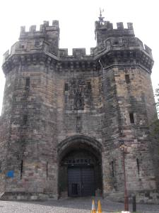 The 1399 gatehouse at Lancaster castle is similar in style to the lost 15th century gatehouse at Halton Castle, Cheshire.